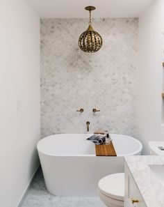 Go for a freestanding tub | Apartment Bathroom Ideas To Steal For Your Space
