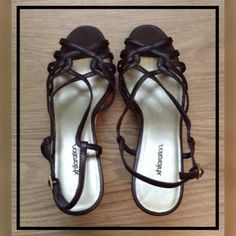 Brown Wedge Strappy Sandal Brown wedge straps sandal never worn. Faux leather. No shoe box. Xhilaration Shoes Wedges
