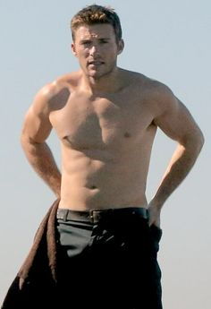 Scott Eastwood showed off his washboard abs as he stripped down to a wetsuit before going surfing. See the pics at Usmagazine.com!