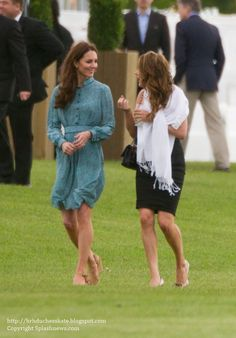 Catherine, Duchess of Cambridge watches Princes William and Harry play polo during a charity match at the Coworth Park Polo Club in Ascot, England, May 13, 2012.
