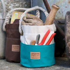 Small Ditty Bag - Two Tone Traditionally used by sailors onboard ship the Ditty Bag has outside pockets, a hand-spliced rope handle and sturdy brass eyelets - perfect for gardening tools, artists materials, or any collection of bits and bobs in need of a home.