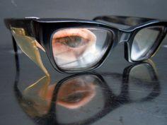 vintage False Prosthetic Eye with Black thick rimmed glasses