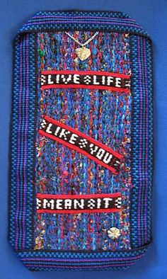 The motto, background and frame were all woven by me on various inkle looms.