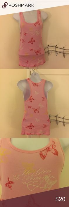 """VS Pink """"he gives me butterfiies"""" tank top Beautiful pink ribbed racer back tank top from Victoria Secret.  Size is xs/s.  Wide openings on either side.  One small tear near right arm.  Pic depicted in 4th pic.  Hardly noticeable.  It says - he gives me butterflies.  Bust is approx. 26 inches and length is 23 inches PINK Victoria's Secret Tops Tank Tops"""