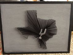 This string art is of the San Antonio NBA Spurs logo in the center of Texas. Gray background with a black border. Custom colors and logo