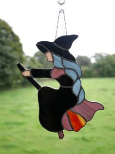 Stained Glass Halloween Witch on a Broomstick Suncatcher - Lucinda