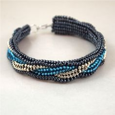 Another version of Simple Bead patterns tubular flat Herringbone pattern in teal, black and silver
