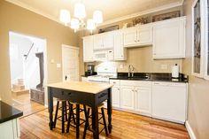 Traditional Kitchen with Hardwood floors, Chandelier, Breakfast bar, Jeffrey alexander - isl04-dbk kitchen island, One-wall