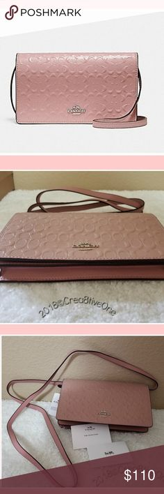 """AUTHENTIC COACH - *NEW* WITH TAGS - Blush bag AUTHENTIC COACH - PINK (Blush) Signature Embossed Fold-over Crossbody Clutch bag - large Signature debossed patent leather.  Eight credit card slots, full-length bill compartment. Inside zip pocket. Snap closure. Silver tone hardware. Detachable strap with 23"""" drop for shoulder or crossbody wear. approximately 8"""" (L) x 4 3/4"""" (H) x 1 1/2"""" (W) Please ask questions if unsure about product. Purchased at Coach store. NEW with TAGS. See photos. Comes…"""