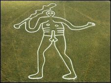 """The Cerne Abbas Giant, Dorset, England. Carved into the chalk hillside, probably in the 17th Century at the time of the English Civil War.  Ladies sit on his grassy """"appendage"""" to help their fertility."""