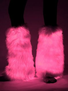 A hot girl raver wearing pink light up fluffy leg warmers from Electric Styles.