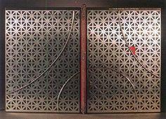 Bound by Christine Chartrand: La Tour Eiffel des Artistes, Éditions Beaux-Arts. Reliure à plats rapportés, décor en peau de veau et en aluminium. Fil d'étain en mouvement. Titré à l'or. Structure du dos en laiton. Gardes en papier chyogami.
