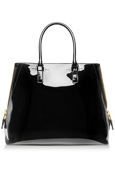 Tom Ford - 2014 Spring-Summer. A good basic (but shiny!) black bag good for work and out.
