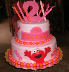 Pink Elmo Cake - Elmo cake to coordinate with invitations and party favors for my daughters 2nd birthday party.  Iced in buttercream, border is gumballs, all other decorations are fondant and gumpaste.
