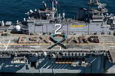 """More than 630 Sailors, Marines and civilians aboard the Wasp-class amphibious assault ship USS Essex (LHD 2) from a teal ribbon and spell out """"ESX ARG"""" to show support for Sexual Assault Awareness and Prevention Month.  Photo: U.S. Navy"""