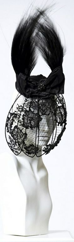 Anya Caliendo RTW Spring 2014 #millinery #judithm #hats Lace, veiling, wire and feathers.