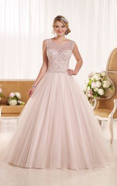 This designer A-line bridal gown from the Essense of Australia wedding dress collection is made from ethereal tulle and features a fitted bodice with a sweetheart neckline under a Diamante embellished illusion tank.
