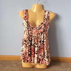 Babydoll Top Cream colored top with black, peach, coral, and red pattern. Worn a handful of times Candie's Tops