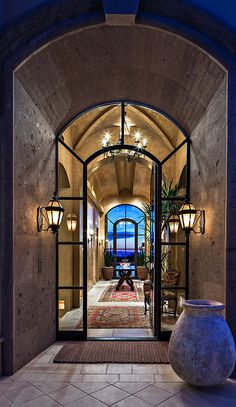 Dramatic Stone Entryway with Glass Front Door House Design, House, Stone Entryway, Home, Design Remodel, Tuscan Decorating, Mediterranean Home Decor, Interior Remodel, World Decor