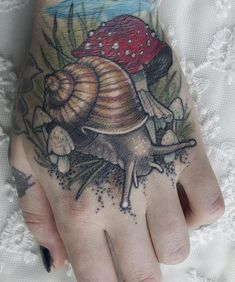 Neotraditional snail and mushroom scar cover by Sam Smith at Scythe & Spade; Calgary, Canada.