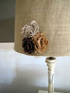 Cute. Lamp shade with hot glued burlap on it with felt flowers. Basic/rustic/girly.