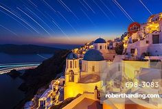 Oia village and churches with star trails after sunset, Santorini (Thira)…