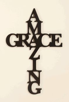"[""Decorate your home with Amazing Grace, but in the shape of a cross. It is 30\"" x 12\"" and perfect for hanging in any room.""] $24.99"