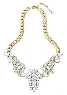 Intricate in detail, elegant in design, this statement necklace features flower design in white and clear color tone. This beautifully crafted necklace goes well with simple dresses or solid color tops.
