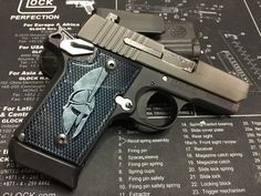 My Sig Sauer P 938 with acrylic grips installed.