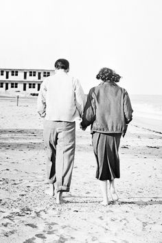 I slept in Frank's pajamas, at least the top half of them, and the next day we walked along the empty beach, me in the bottom half of my travel suit and Frank's jacket. Naturally a photographer was lying in wait and snapped a shot of us, barefoot, holding hands. I've always thought it was a sad little photograph, a sad little commentary on our lives then. We were simply two young people so much in love, and the world wouldn't leave us alone for a second.