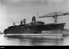 The new French transatlantic liner Normandie, the only CGT (Compagnie Generale Transatlantique) vessel to win the coveted Blue Riband and the first vessel to exceed 1,000 feet in length, at the Saint-Nazaire shipyard shortly after her launch.