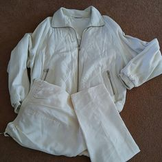 Sweat suit Off white sweat suit. Light weight rayon double pocket, draw string, lined pants. Bubble like zip up two pocket jacket. Did a International Other