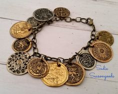 "Vintage metal buttons get SMASHED with a hammer...transforming them into perfect ""antique coins"" for a whimsical charm bracelet. Love this DIY upcycle from #SadieSeasongoods"