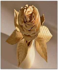 A flower made by pure wood looking so beautiful and very nice work