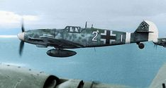 Lt. Josef Emil Clade is flying this Messerschmitt Bf 109G-6 while escorting a Heinkel He 111H over Crete on December 1, 1943. Colorized photo .