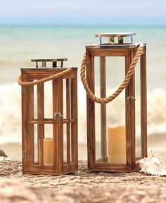 This Wood LED Candle Lantern brings a oceanside touch to your home. Can be used indoors or outdoors. It has a wood frame with acrylic panels to withstand the weather. A thick rope handle and shiny stainless steel accents complete the look. The battery-op