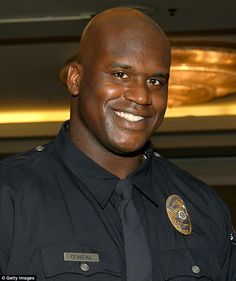 Shaquille O'Neal, seen here in his Port of Los Angeles Police Officer uniform, wants to get back into law enforcement as a reserve officer in Florida