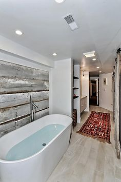 Master Bathroom Boose Butcher Block Shelving, Soaking tub, Barnwood Walls, Reclaimed Barn wood Doors, Kilim Rugs, White stone tile floors, 4502 N Magnolia Unit 1N Sheridan Park - Uptown - Chicago, Illinois - Christian Schaller Johnson Roberts Associates Architects Inc. 2015 For sale @ $485,000