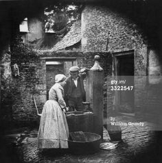 A domestic servant washing fish at the pump. Get premium, high resolution news photos at Getty Images Antique Photos, Vintage Pictures, Vintage Photographs, Old Pictures, Vintage Images, Old Photos, Water Pictures, British History, American History