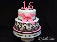 Maybe teal or turquoise instead of pink.  Sweet 16 cake by K Noelle Cakes