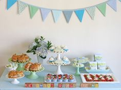 Smart baby shower food ideas to keep entertaining stress-free: Dress up your buffet table with your kids' toys. This display from Glorious Treats is so beautiful, and so smart.