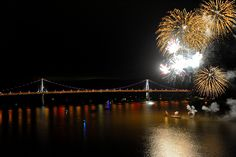 Spectacular fireworks seen from the Walkway Over the Hudson, looking down on the Mid Hudson bridge. Many other great photos by Scott Crist showing the bridge under construction, nearing completion, and finally the incredible grand opening.