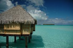 Bora Bora was added to my list of places to go after I watched the Kardashians vacation there..lol  I want a hut on the water just like this one.