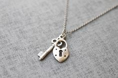 Vintage style cute mini lock and key necklace - S2069. $14.00, via Etsy.