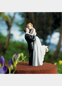 This adorable cake topper perfectly represent a couple completely in love. Measures 5.75 inches tall with a 2-inch base. Topper weighs 5.6 Ounces.