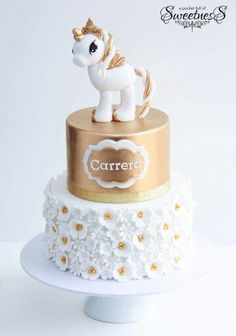 Gold & white tiered unicorn cake