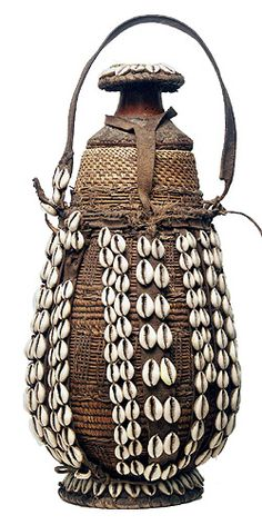 Africa | Ethiopian vessel. Used to carry and store milk || Made from gourds, basketry, mud/clay and leather and adorned with cowrie shells.