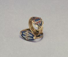 Two Rings with Lotus Flowers Egypt | 1400-1200 BC (New Kingdom) | gold with glass, lapis lazuli, and carnelian inlay