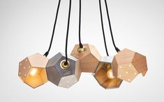 This Lighting System Uses Magnets To Combine Multiple Lamps Into Large Arrangements
