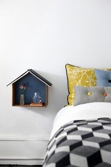 Studio 1: A cache for those little comforts next to your bed. Hang it on the wall or put on the floor. Prop up your favorite book on the roof to keep your place. Tuck a glass of water inside. Made of plywood. EUR 79.95